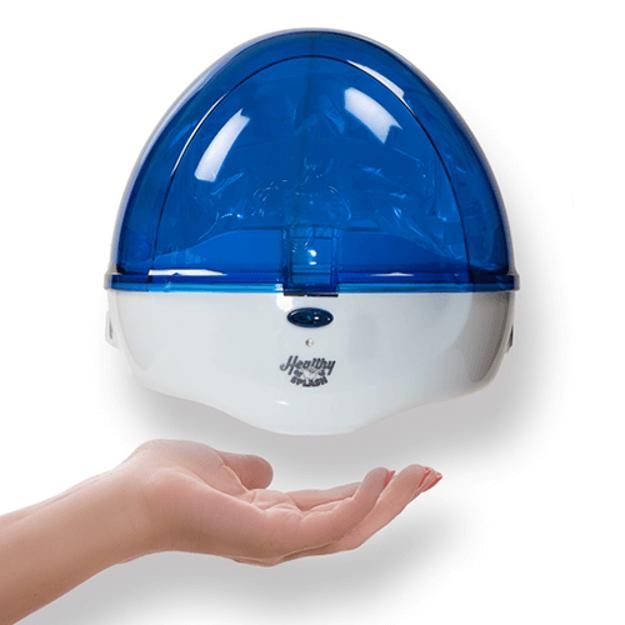 A hand using the blue healthy splash dispencer